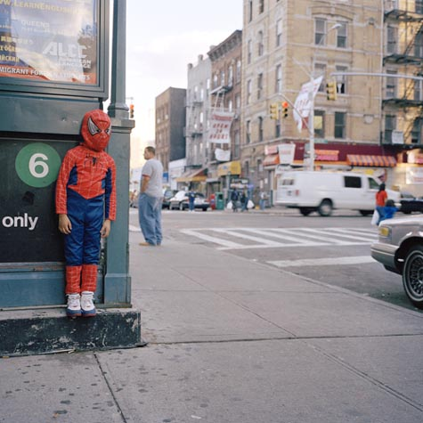 Hiding Behind A Corner Wearing A Spider-Man Costume