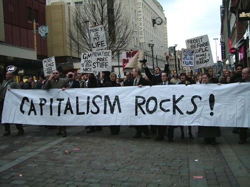 Capitalism Rocks Protest Banner
