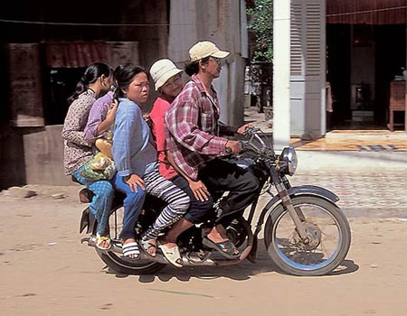 Four People On A Motorcycle