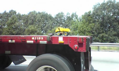 Flatbed Hauling A Tonka Truck