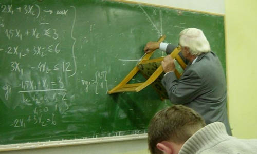 Using A Chair To Draw A Straight Line On A Chalkboard