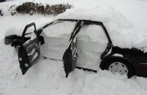 Car Filled With Snow