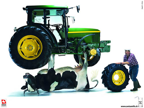 Swiss Milk Ad | Cow Holding Up A John Deere Tractor While Farmer Changes A Tire