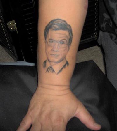 (source) Most of us find Steven Colbert funny, but to get his face tattooed