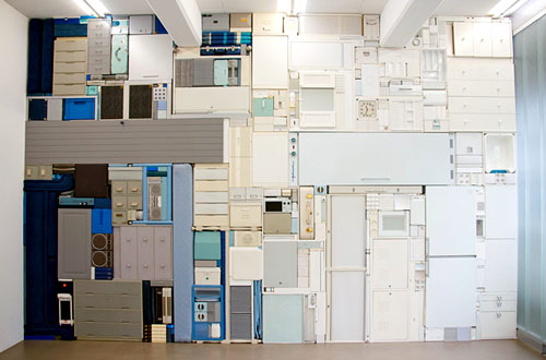 Wall of Stacked Furniture, Cabinets And Appliances