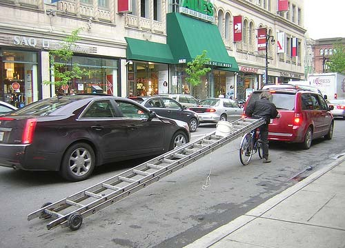 Bicycle Towing A Ladder