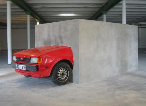 Car in a block of cement