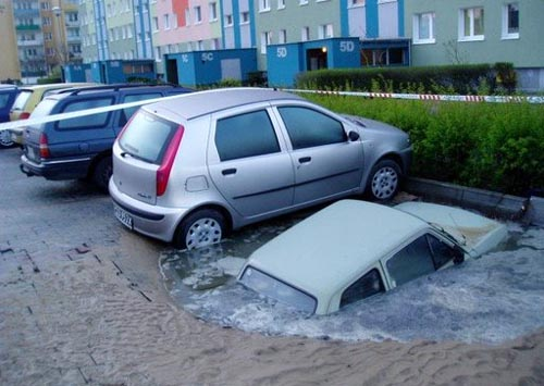 http://www.foundshit.com/pictures/cars/sink-hole-01.jpg