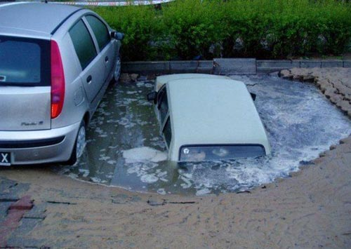 Car Disappearing In A Parking Lot Sink Hole