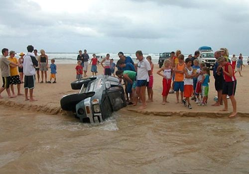 SUV Buried In A Beach Sinkhole