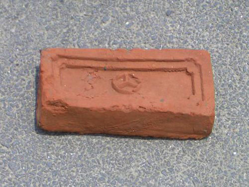Brick With A Peace Symbol