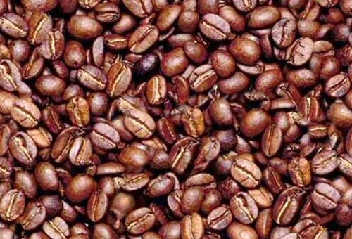 Mans Face In Coffee Beans
