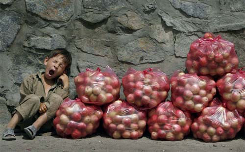 Kid Yawning While Selling Apples