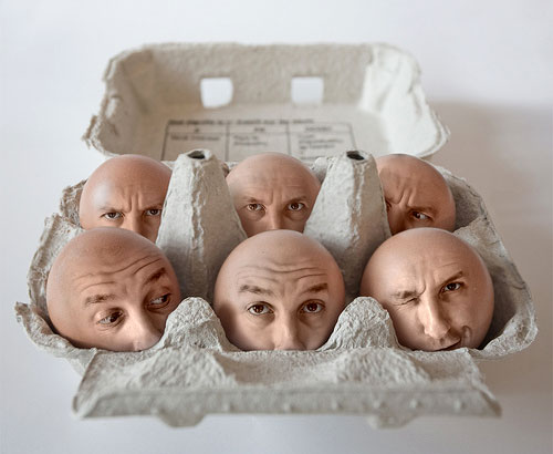 Six Egg Faces In A Box. c/o Pierre Beteille. Posted in: Bizarre, Images