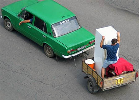 Holding A Refrigerator Upright In A Trailer While Being Towed