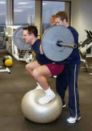 Lifting Free Weights While On A Balance Ball