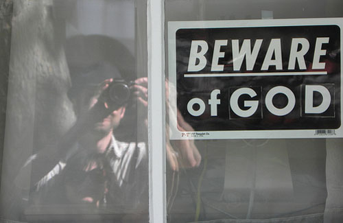 Beware of God Sign