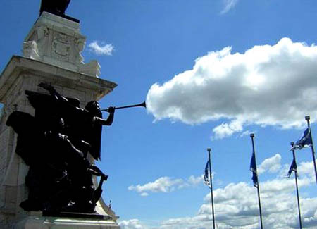 Statue Blowing A Cloud Out Of Its Horn