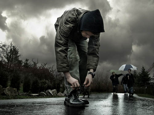 Boy Ties His Shoe As Storm Brews | Photography By Frank Melech