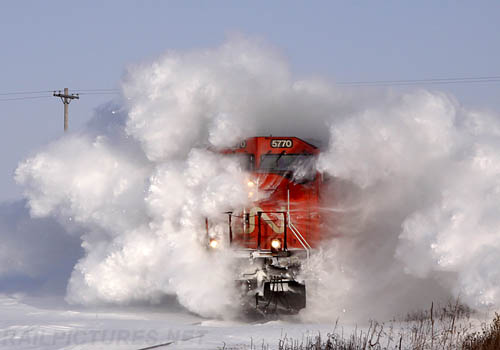 CN Train Driving Through Snow Drift
