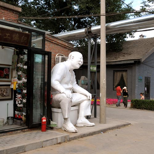 Big Sitting Man Sculpture In Beijing