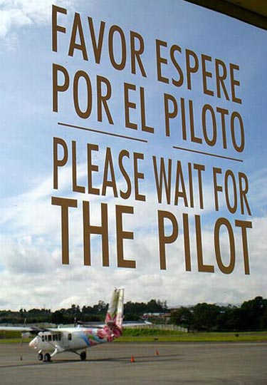 Please Wait For Pilot Airport Sign