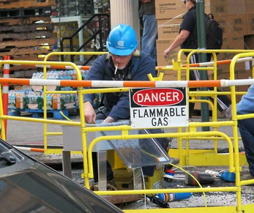 Flammable Gas Sign With Worker Smoking
