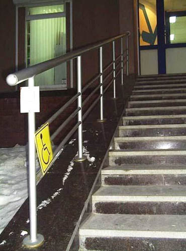 Wheelchair Accessible Sign Next To Flight Of Stairs