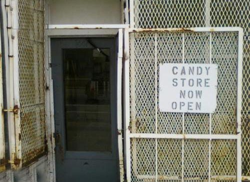 Caged Candy Store Now Open Sign