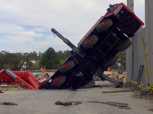 Crane Collapses Through Parking Lot